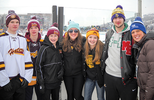 Aimee Curtis Administrator, Community Relations and Minnesota Power Foundation, with students at Minnesota Hockey Day
